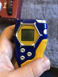 Blue and yellow Digimon digivice