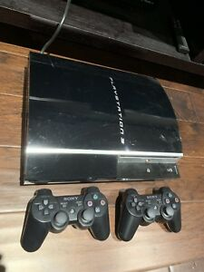 PlayStation3 with 2 Controllers and a tennis game
