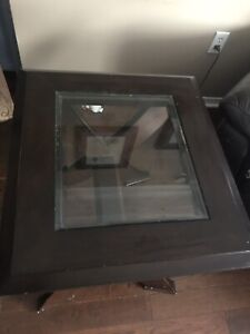 2 dark wood and glass end tables