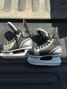 Two pairs of size 12 hockey skates