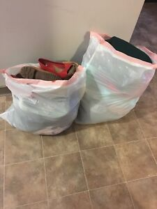 Two huge bags of clothing shoes and more
