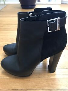 Micheal Kors black leather and suede bottoms size 7.5
