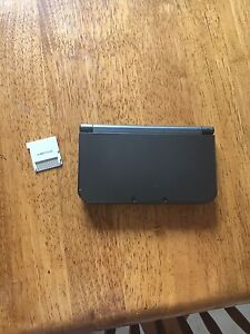 New Nintendo 3ds xl with charger and game
