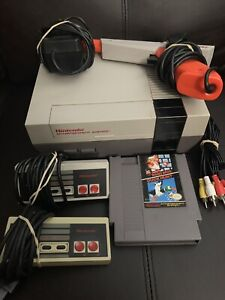 Nintendo system with Mario, 2 controllers and zapper