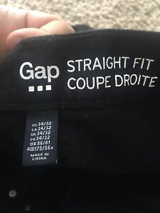 Brand new men's black GAP jeans.