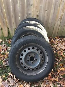 4 winter tires on steel rims. 195/65R15