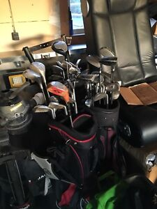 3 sets of golf clubs. 3 Bags and 1 pull cart.