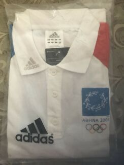 2004 Athens Olympic volunteers polo shirt brand new unopened packet.