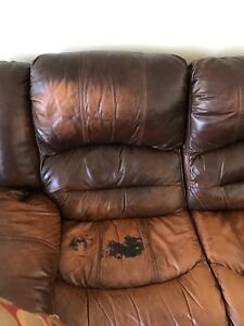 L shaped brown leather couch