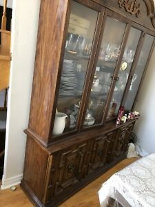 Antique Dining table made of Wood with 7 chairs and wall unit