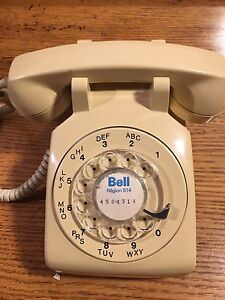 Vintage bell canada rotary telephone in beige