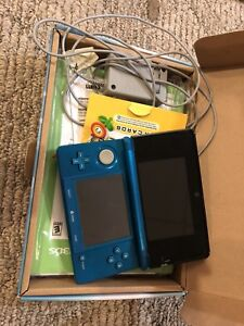 Original red DS, blue 3DS, white DSi, and games