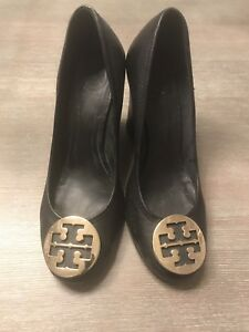 Tory Burch black wedges with gold insignia Size 8