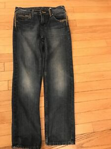 Beautiful brand new Guess jeans for 10 years old boys or girls.