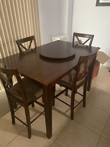 Dining table counter height with 8 chairs and lazy susan