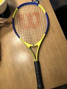 Raquette tennis 20$