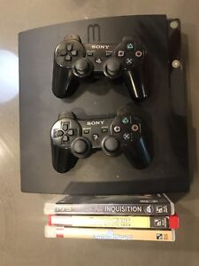 PS3 w/Controllers and Games