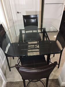 Glass table with 4 chairs $125