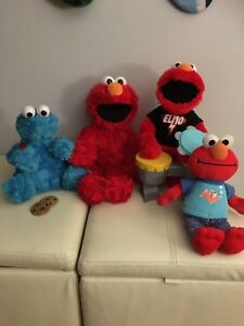 3 Elmos and 1 cookie monster
