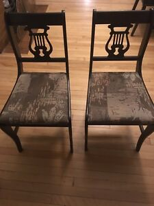 2 antique dark wood chairs