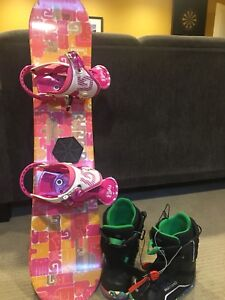 Three snowboard sets.    Two children, one adult