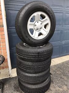 5 GOOD YEAR TIRES WITH RIMS AND SENSORS