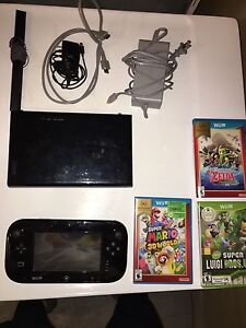 Wii U console with 3 games