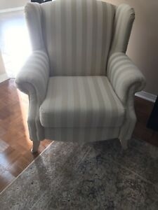 Cream coloured wing back chairs