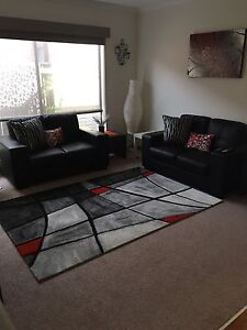 2 seater black sofas Epping Whittlesea Area Preview