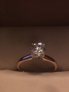 One Lady's 14kt Rose Gold 4-Prong Solitaire Engagement Ring