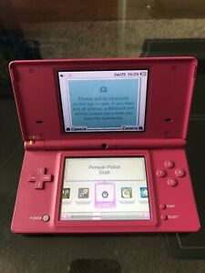 Nintendo DS with charger and game plus band hero