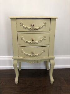Vintage bed side table with distressed finish.