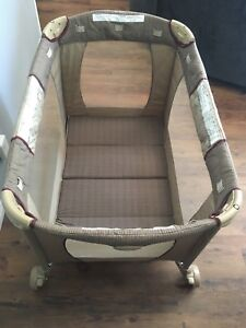 Like new Playpen with Bassinet,Change Table,Storage,Music,Light