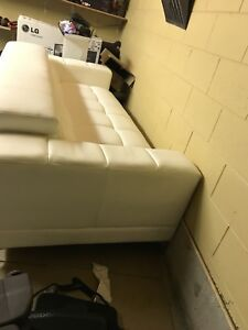 White Leon's leather couch in excellent condition