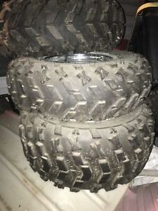2004 Polaris tires and rims new condition.