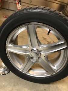 """Toyo 17"""" rims and snow tires. 225 50 R17"""