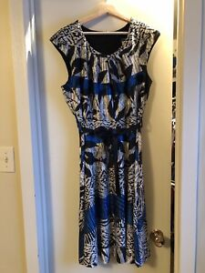 4 dresses Size 12/14      $15 for all 4