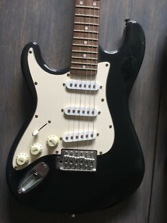 Electric guitar ( left handed ) and amp