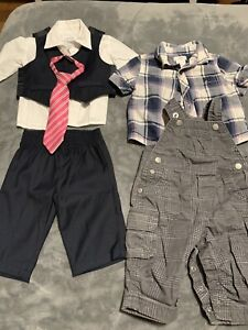 Baby boys dress clothes and baby carrier