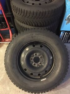 Winter Tires on Rims - 215/70 R16 - like new!