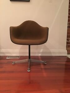 Authentic vintage Herman Miller Eames upholstered swivel chair