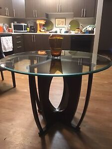Wayfair Round plate glass table with wood base