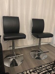 Two black and silver bar stools