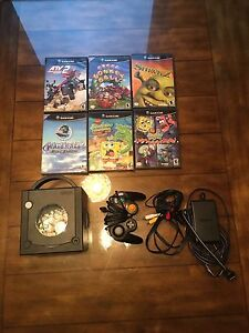 GameCube with games for sale