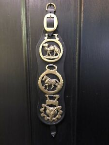 BRASS EQUESTRIAN BADGES ON BLACK LEATHER STRAP