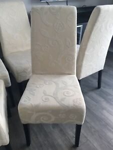 8 dining chairs in cream and white fabric  from Maison Corbeil