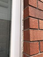 Window Caulking. Seal your home from elements.