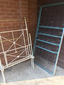 Antique iron and brass single bed with sprung base