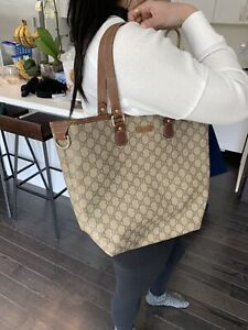 Authentic Gucci Coated leather shoulder bag paid $850