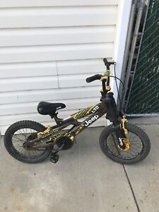 """Like new kids 12"""" wheel bike with front suspension."""